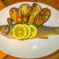 Whole Roasted Branzino With Tomatoes and Onions